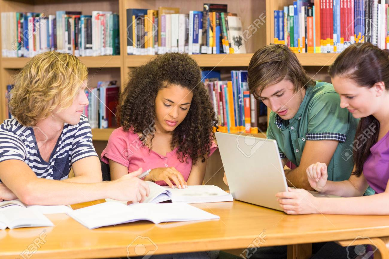 Stock Photo - Group of college students doing homework in the library