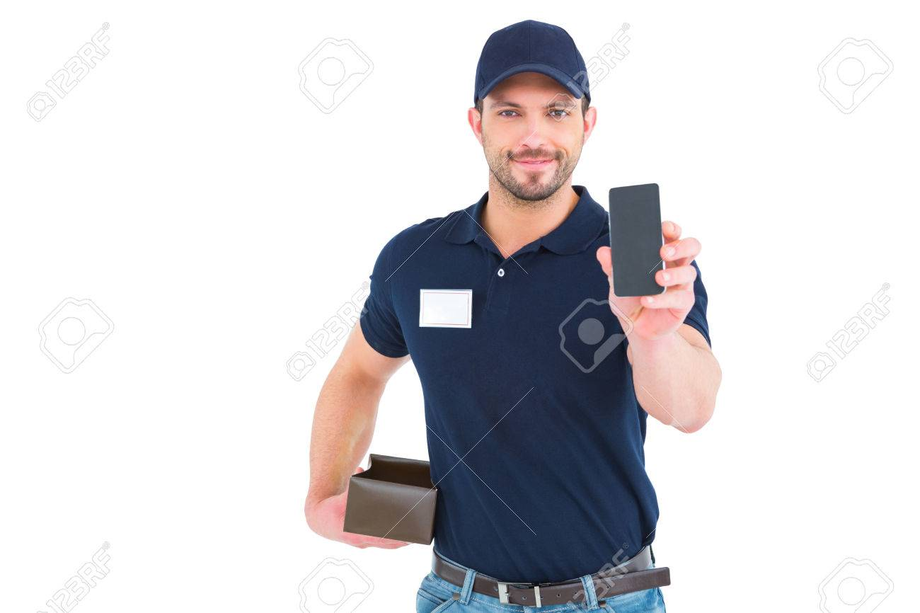 handsome delivery man showing mobile phone on white background stock