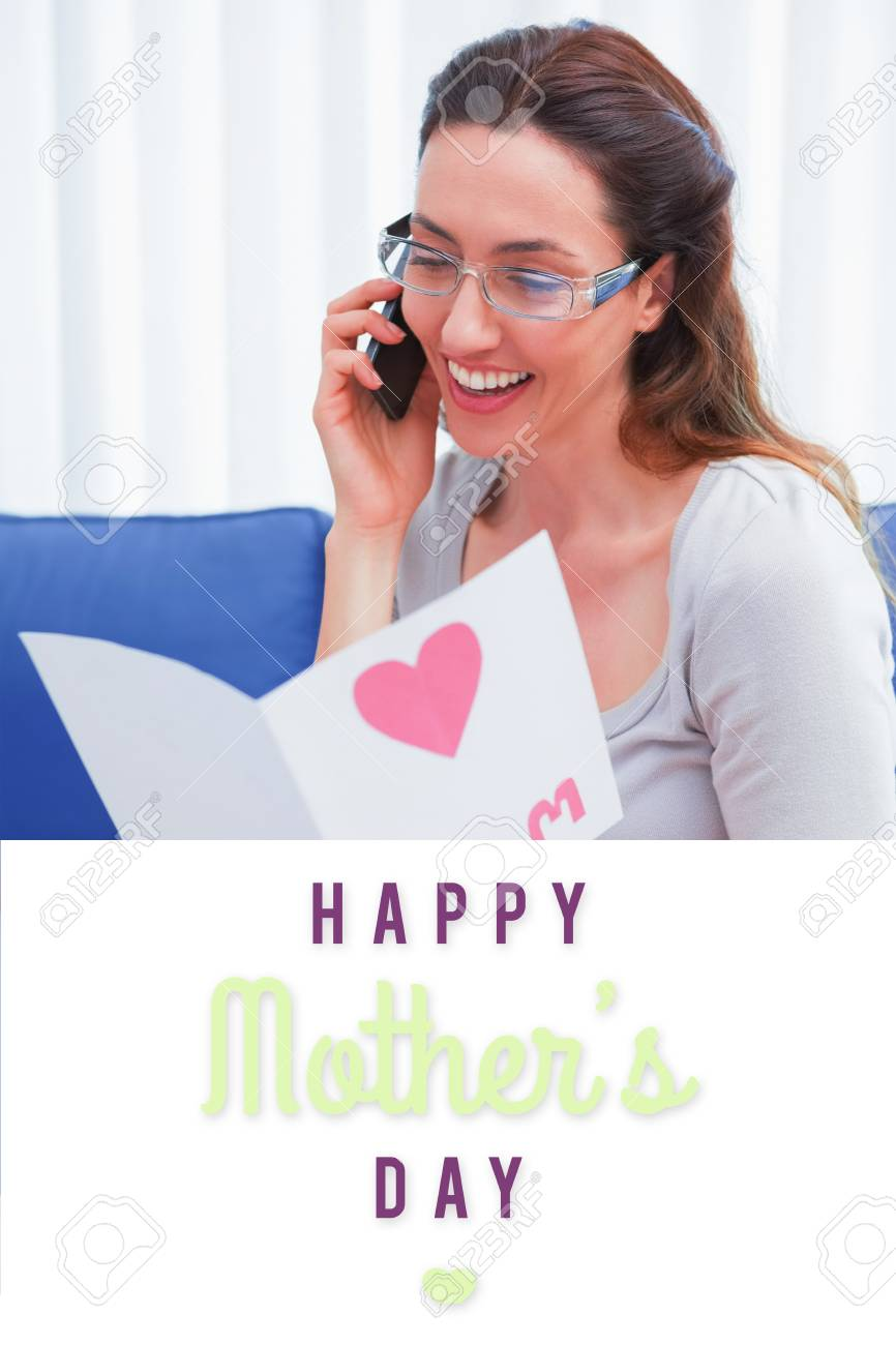 Mothers Day Greeting Against Mother Reading A Lovely Card On Stock