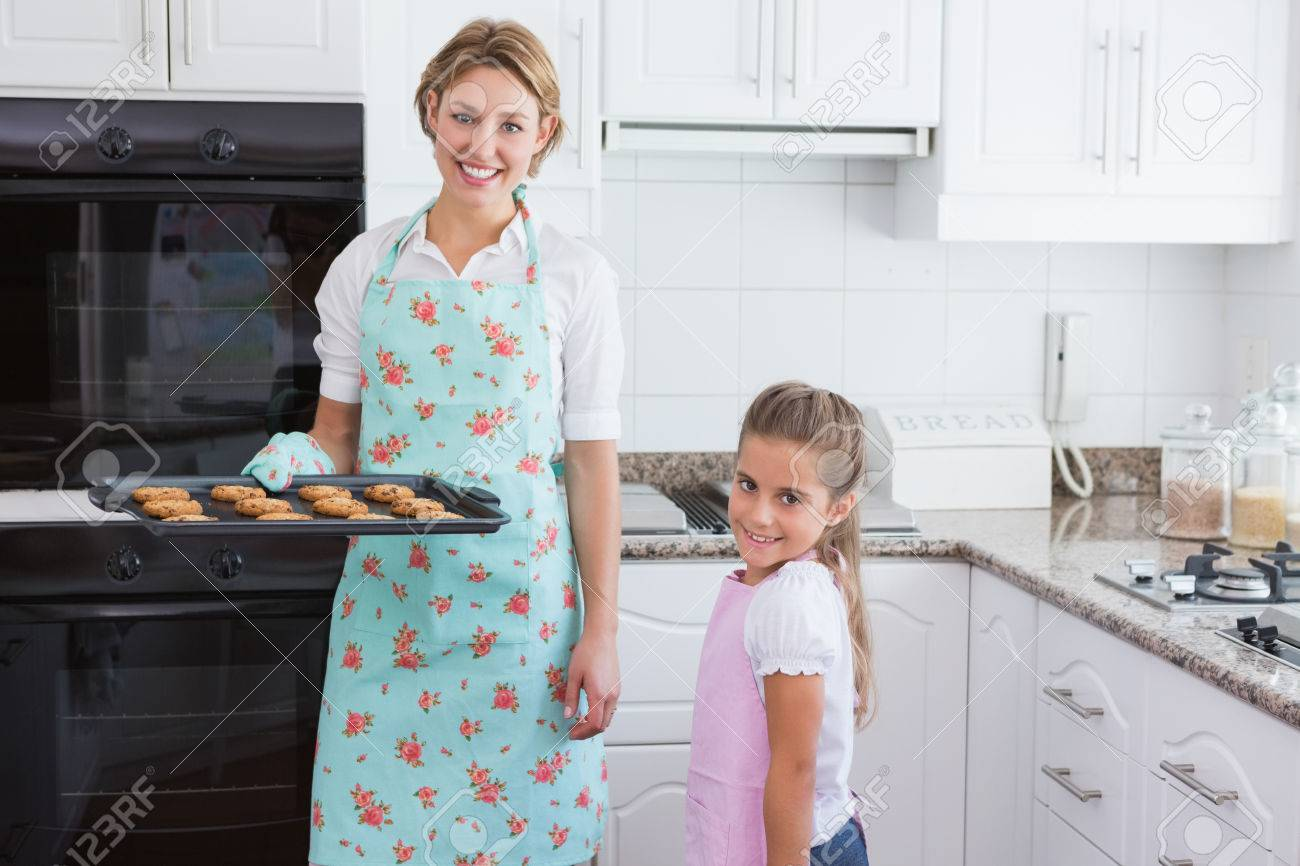 Mother And Daughter With Hot Fresh Cookies At Home In Kitchen Stock ...