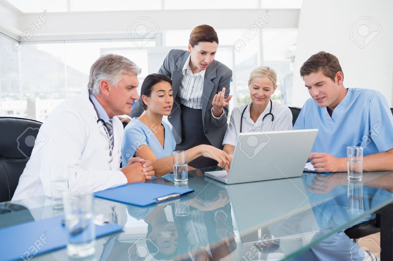 Team Of Doctors And Businesswoman Having A Meeting In Medical.. Stock  Photo, Picture And Royalty Free Image. Image 42226417.