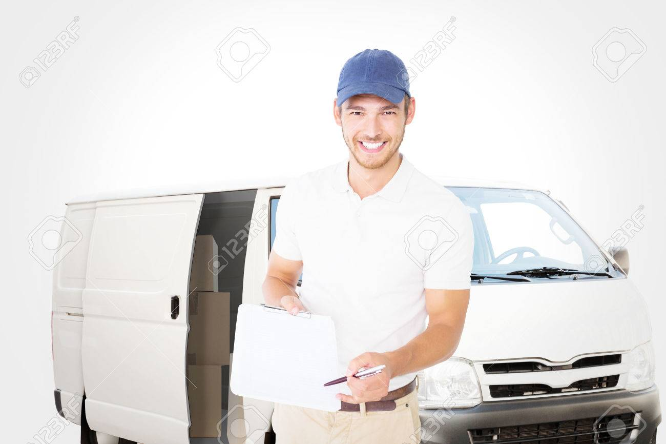 delivery door: Happy delivery man holding clipboard against white delivery van