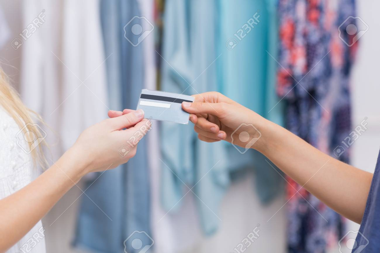 Girls Handing A Credit Card At The Clothing Store Stock Photo
