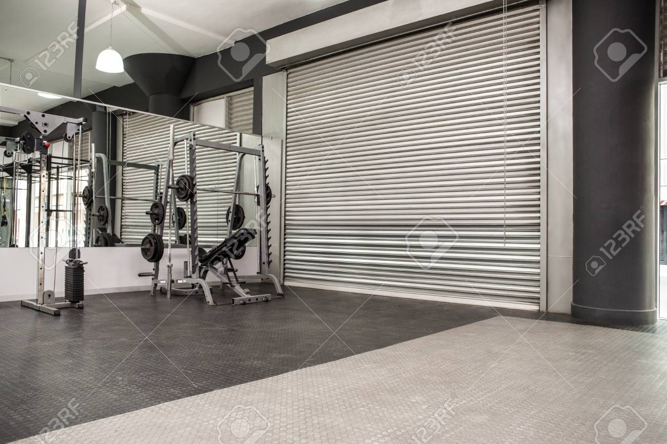 Exercise room with shutters and mirrors in the crossfit gym stock