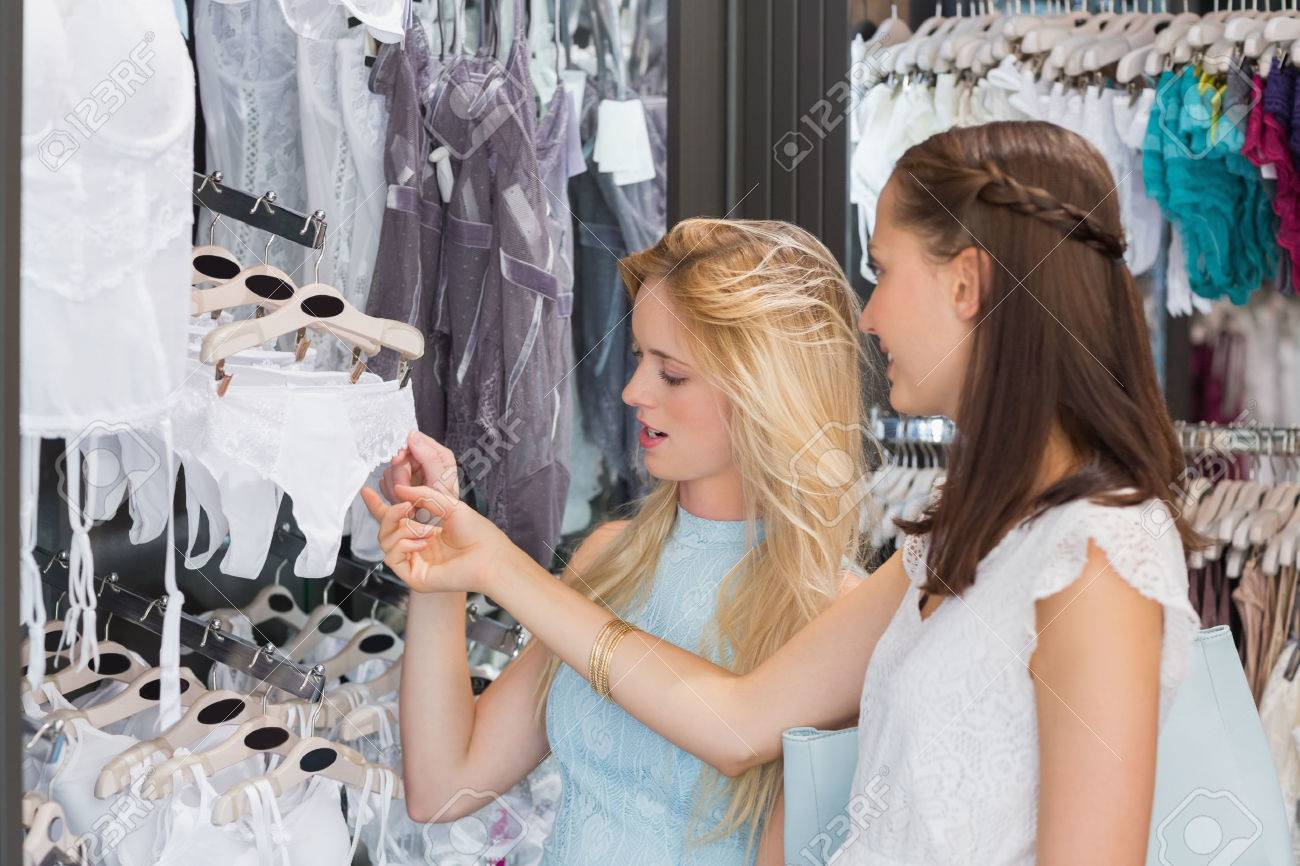 135dcf2eb Happy women looking at underwear in shopping mall Stock Photo - 44814408