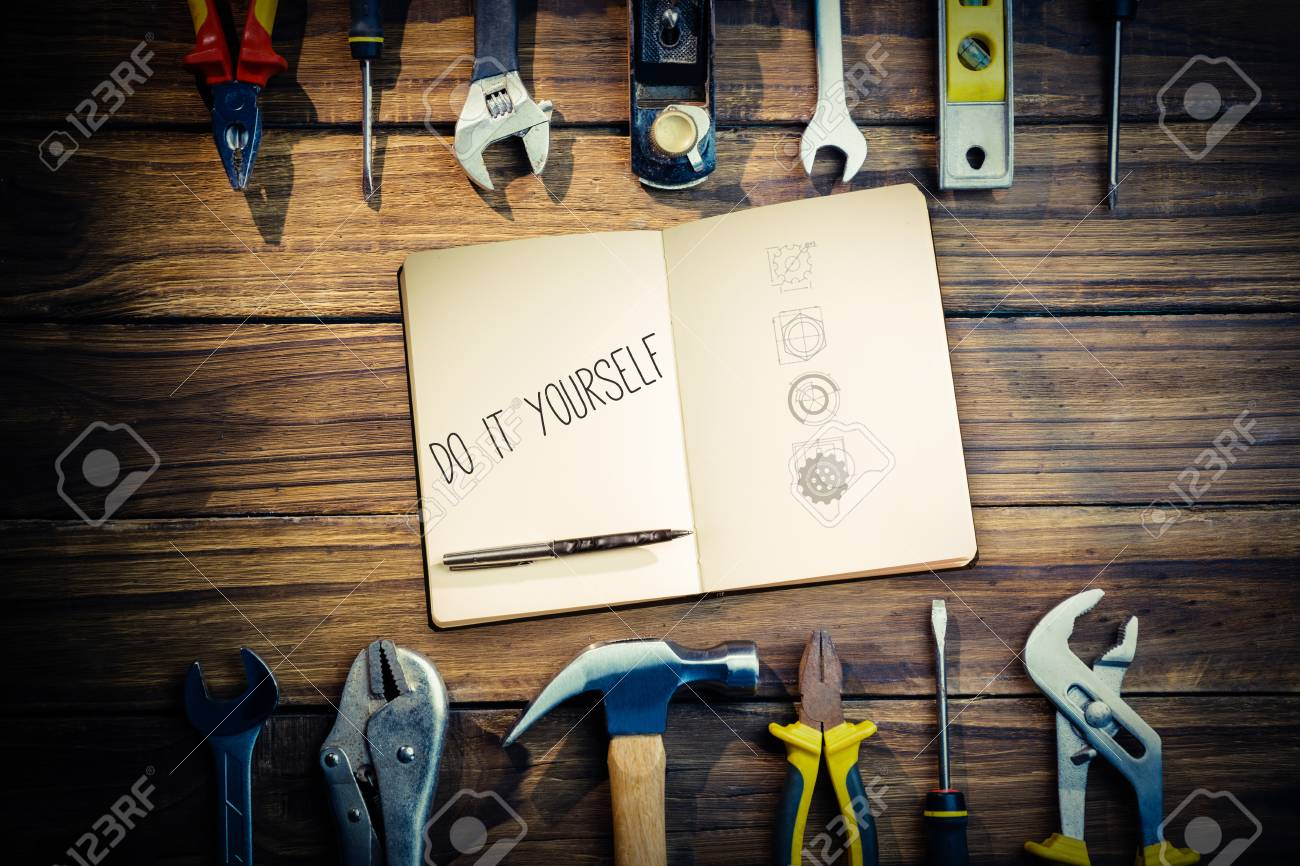 The word do it yourself and notebook and pen against blueprint stock stock photo the word do it yourself and notebook and pen against blueprint solutioingenieria Images