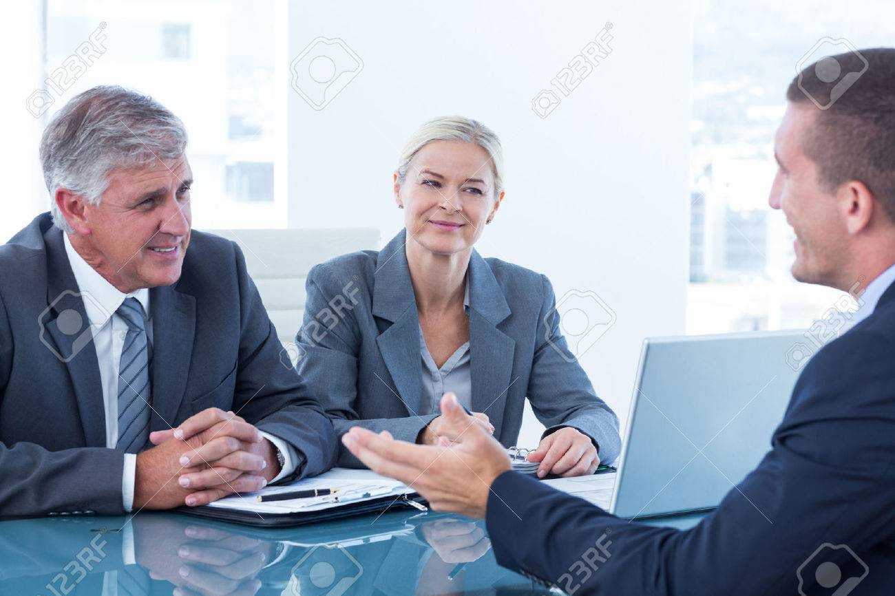 business people conducting an interview in an office stock photo business people conducting an interview in an office stock photo 42560590