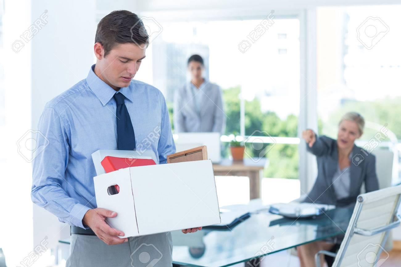 businessman carrying his belongings in box after being fired stock businessman carrying his belongings in box after being fired stock photo 42576995