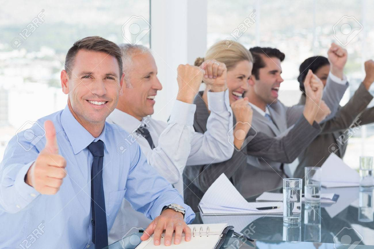 image: 42519073-Business-team-celebrating-a-good-job-in-the-office-Stock-Photo