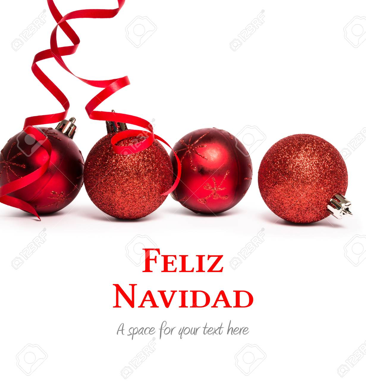 feliz navidad against four red christmas ball decorations stock photo 42607208
