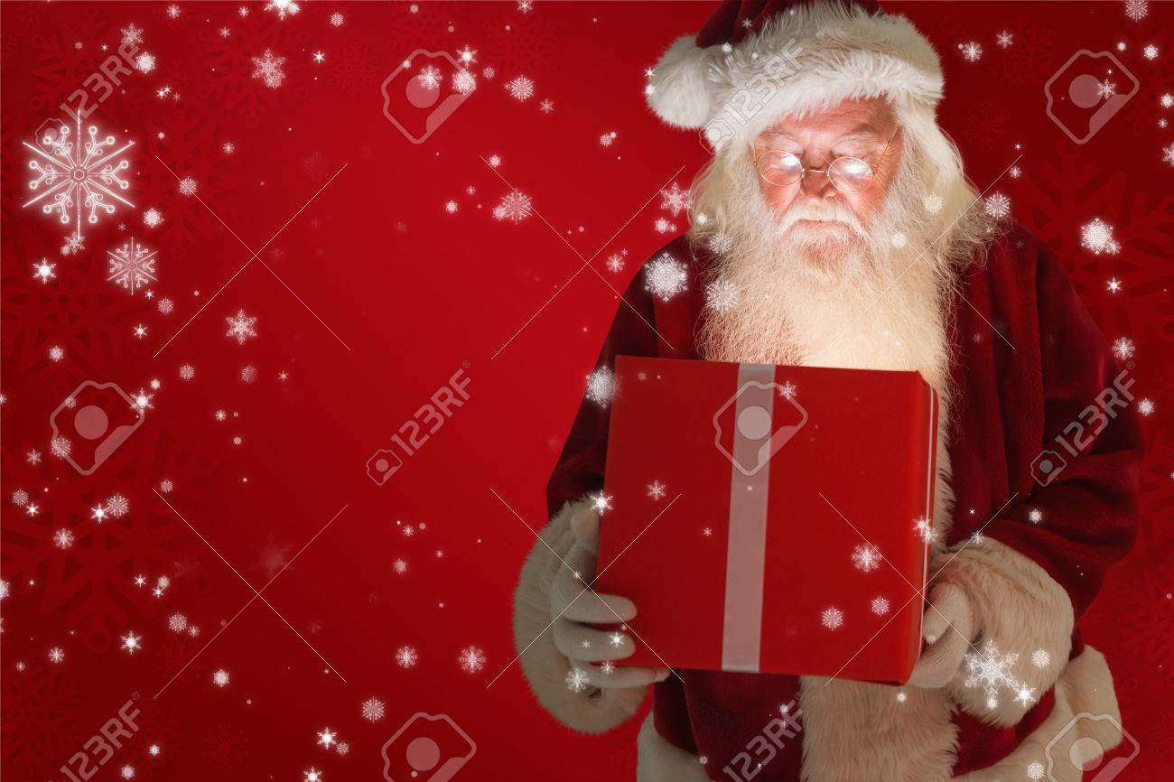 Father Christmas Opening A Magical Christmas Gift Against Red ...