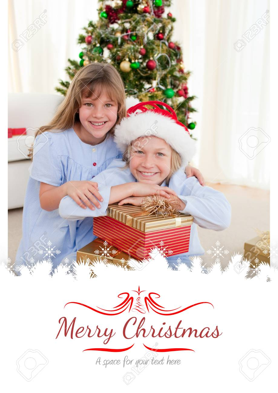 Christmas Presents For Brother.Happy Brother And Sister Holding Christmas Presents Against Border