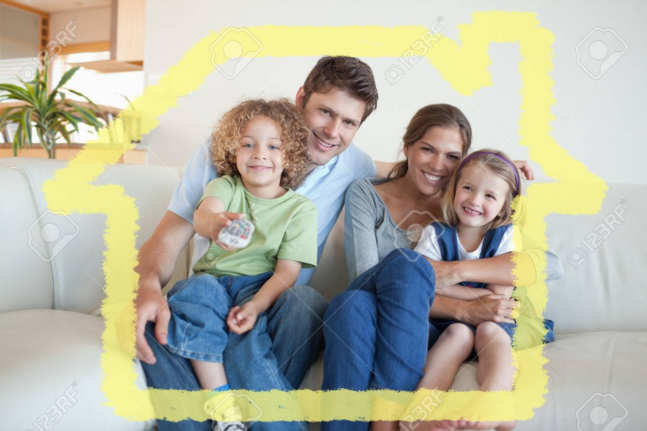 Smiling Family Watching Tv Together Against House Outline Stock