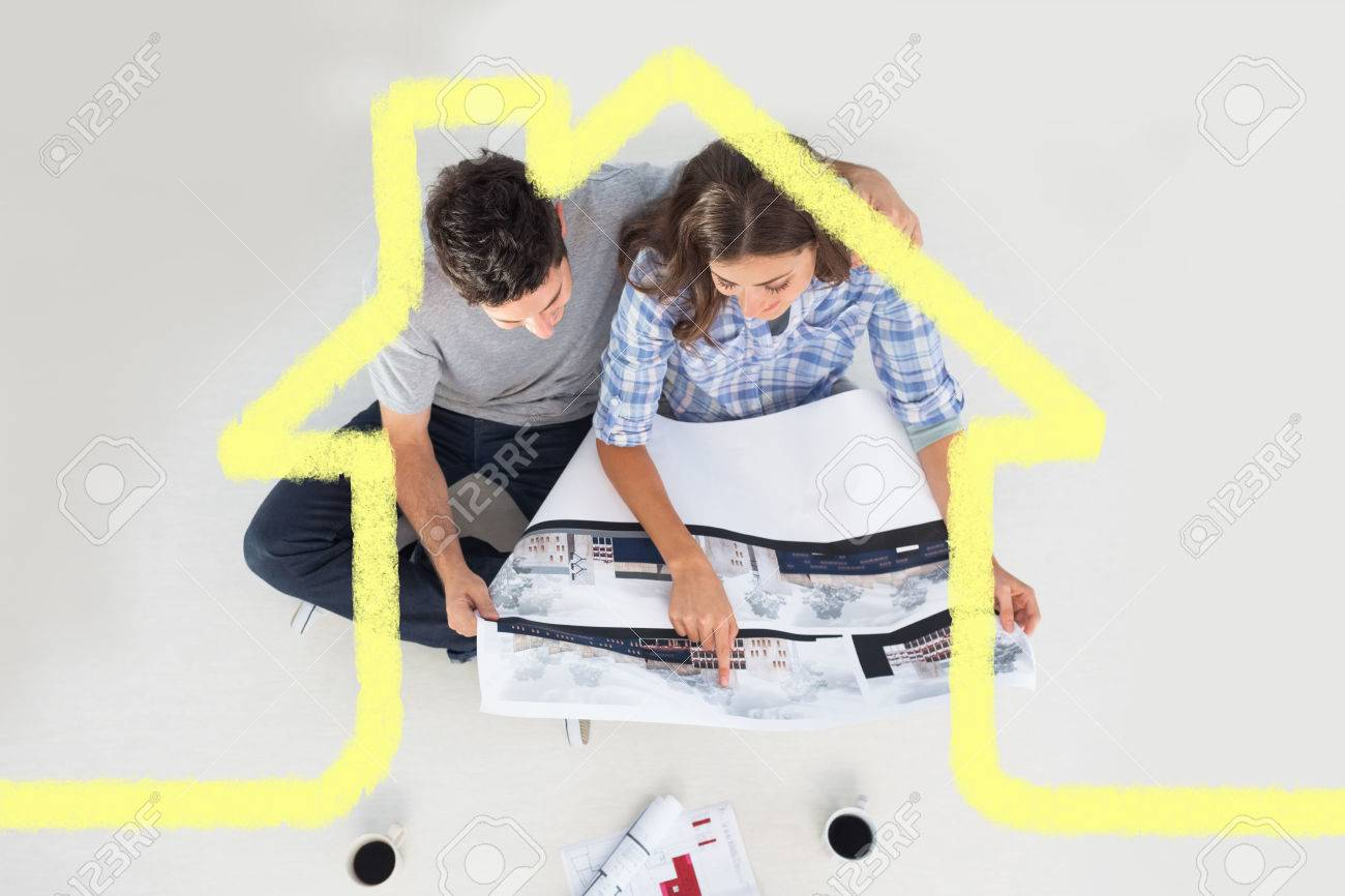Overview Of A Husband And His Wife Looking At House Plans Against