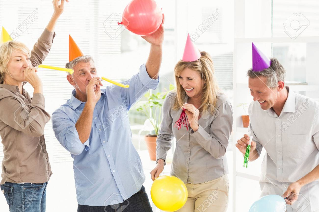 Laughing casual business people celebrating birthday in the office Stock Photo - 44461073