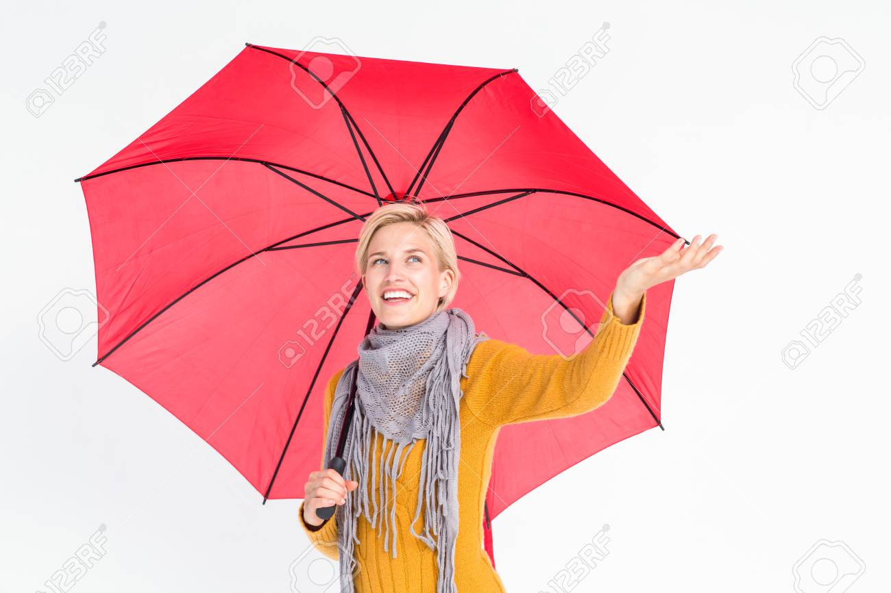 43f6a0269e3 Woman checking to see if its raining while under her umbrella Stock Photo -  45535286