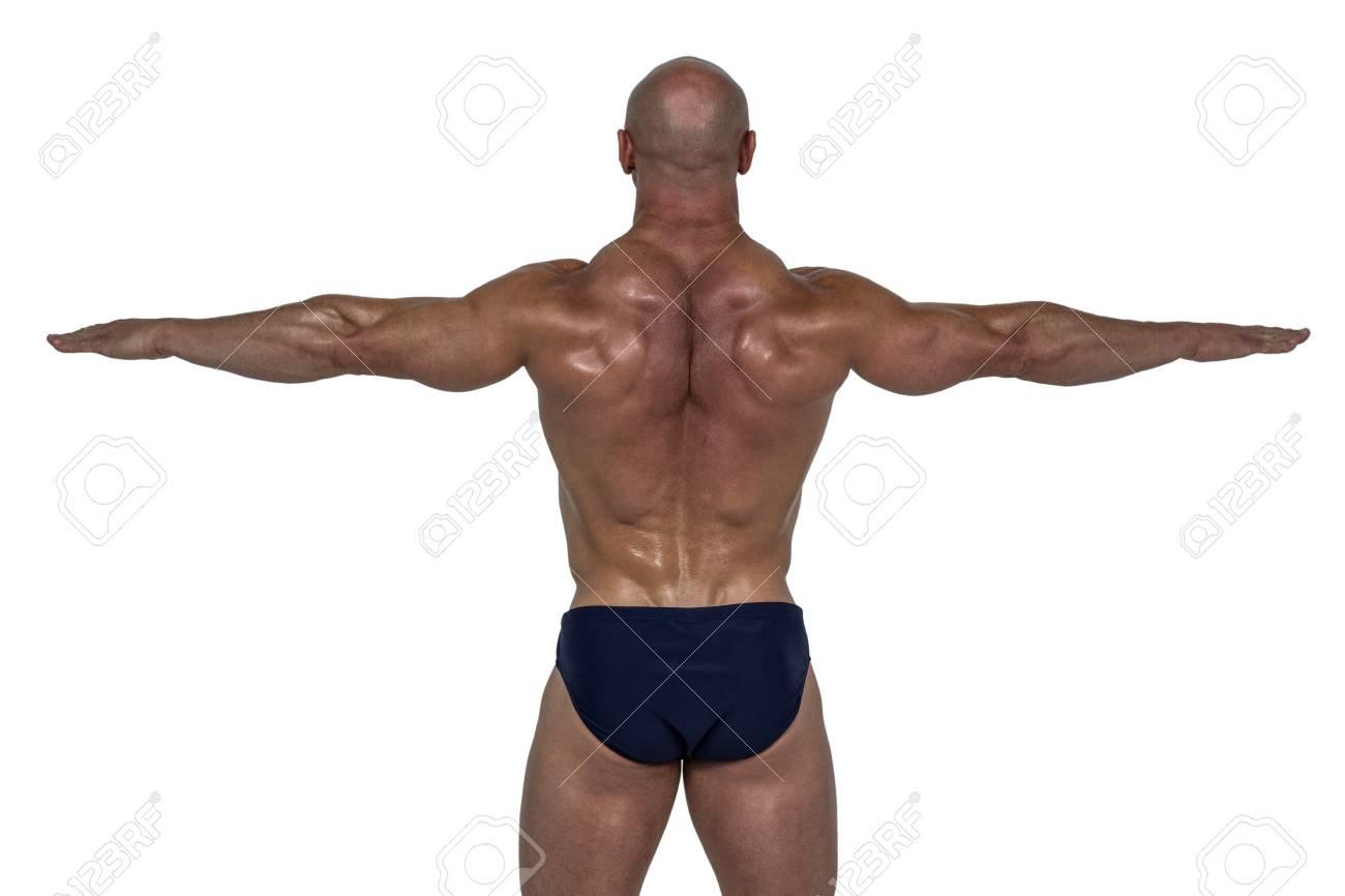 Banque d images - Vue arrière de l homme musclé exercice avec les mains sur  le fond blanc 049038d7e83