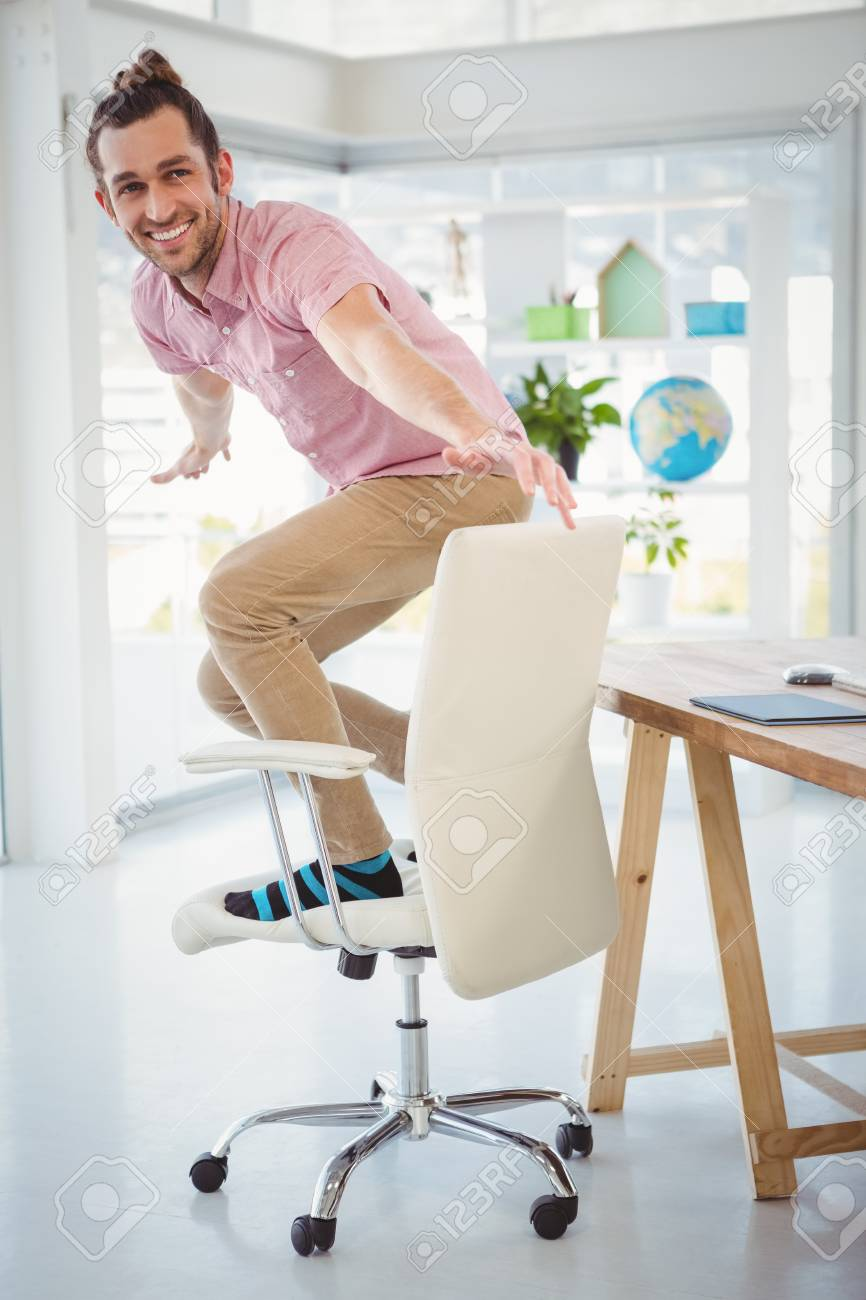 Strange Happy Businessman Standing On Swivel Chair At Desk In Office Pabps2019 Chair Design Images Pabps2019Com