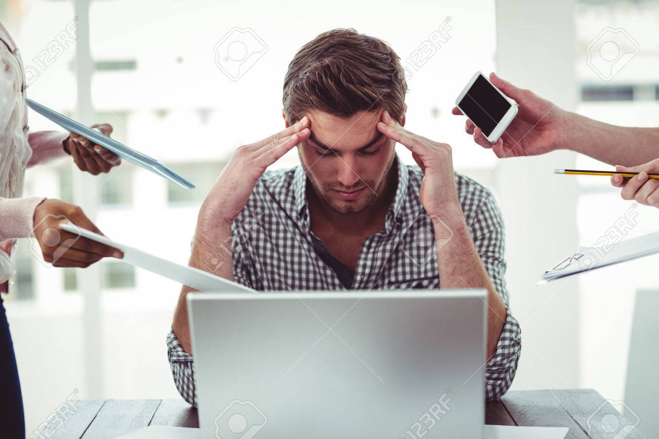 Businessman stressed out at work in casual office Stock Photo - 47404364