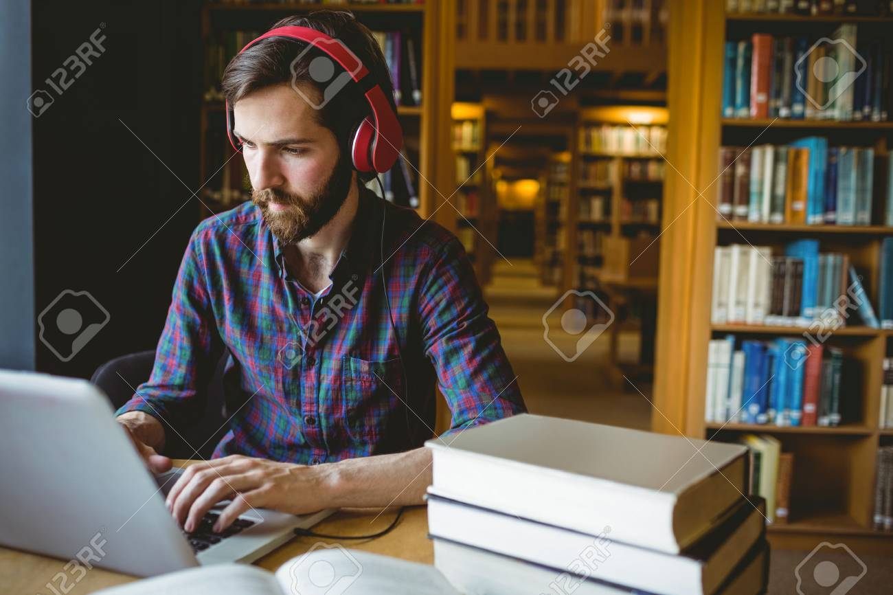 Hipster student studying in library at the university Stock Photo - 47404620
