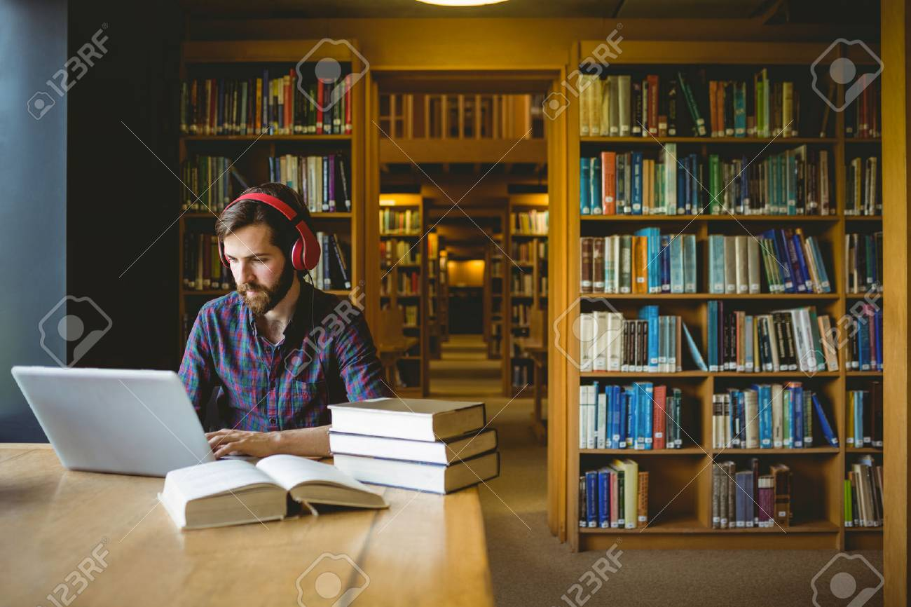 Hipster student studying in library at the university Stock Photo - 47503535