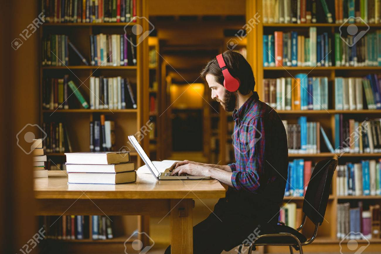 Hipster student studying in library at the university Stock Photo - 47507040