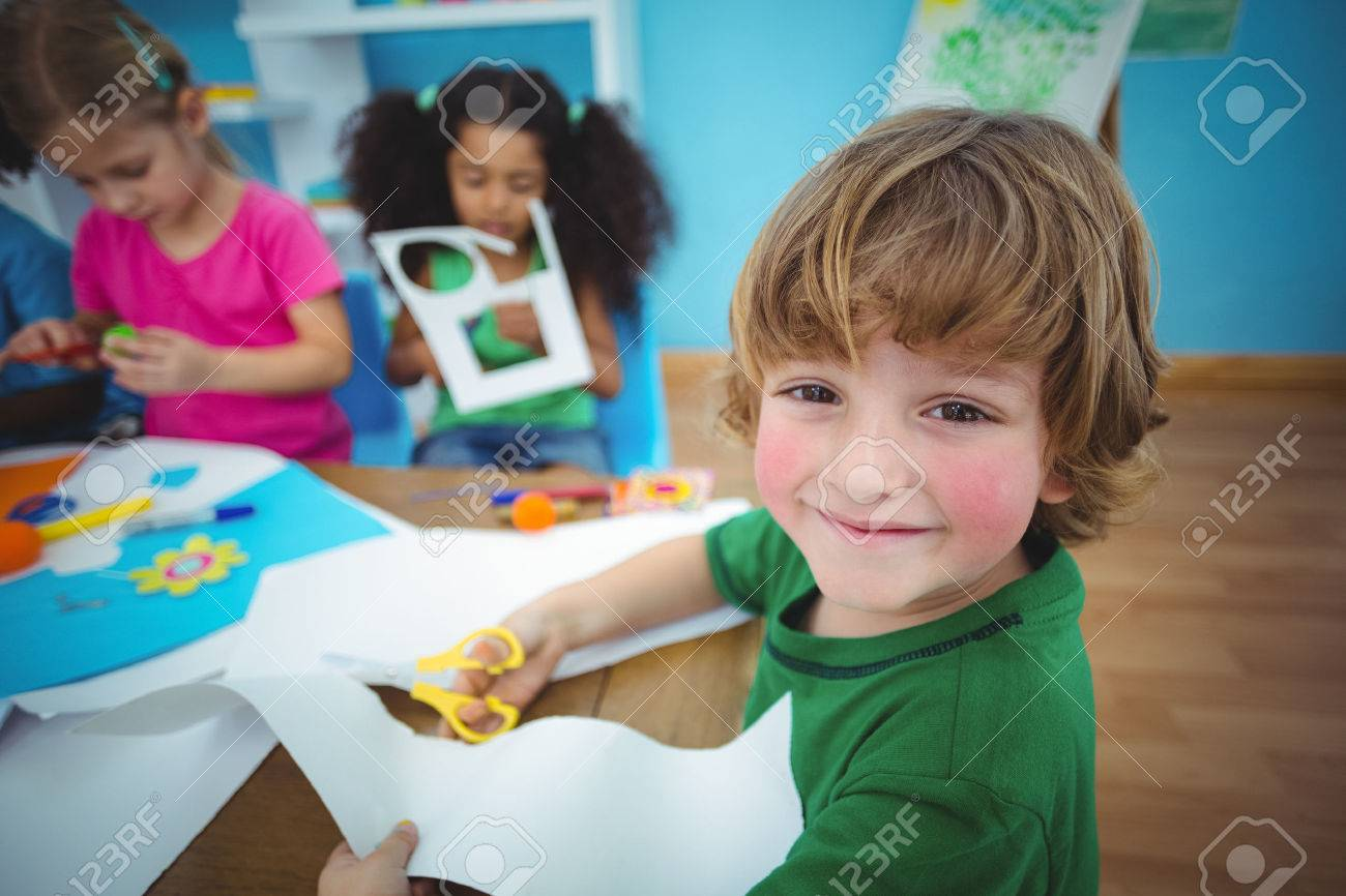 Happy kids doing arts and crafts together at their desk Stock Photo - 47508090