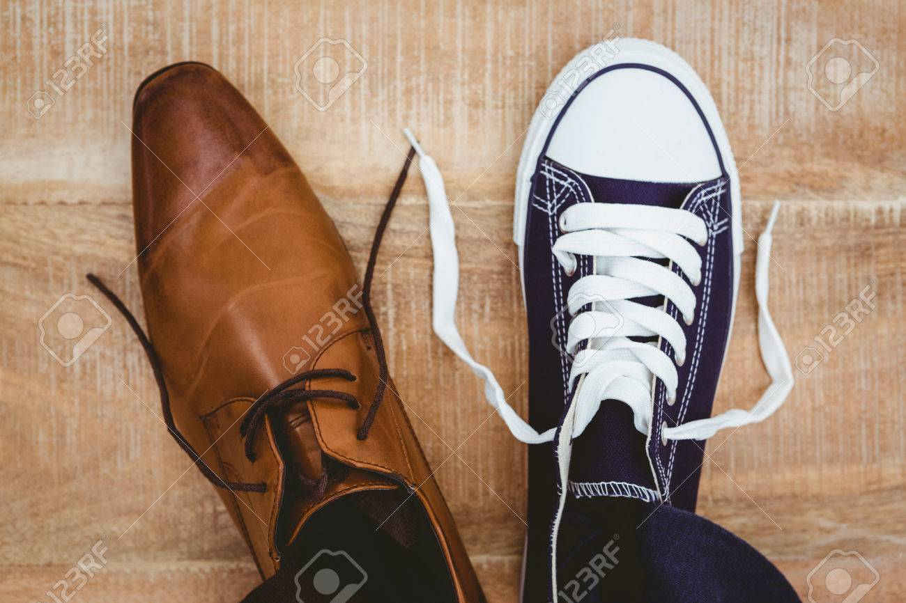 View of two different shoes on wood plank Stock Photo - 47508445
