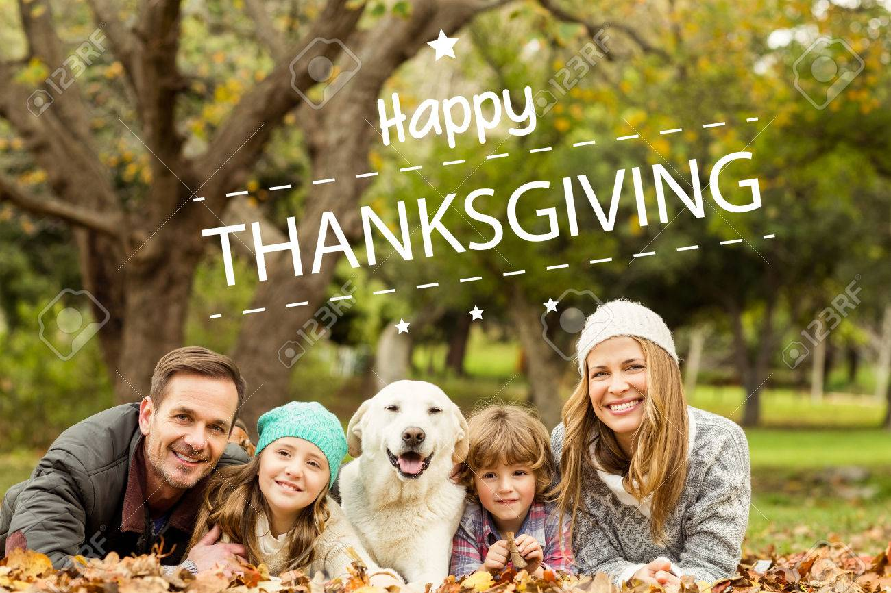 Happy thanksgiving against young family with a dog Stock Photo - 47543309