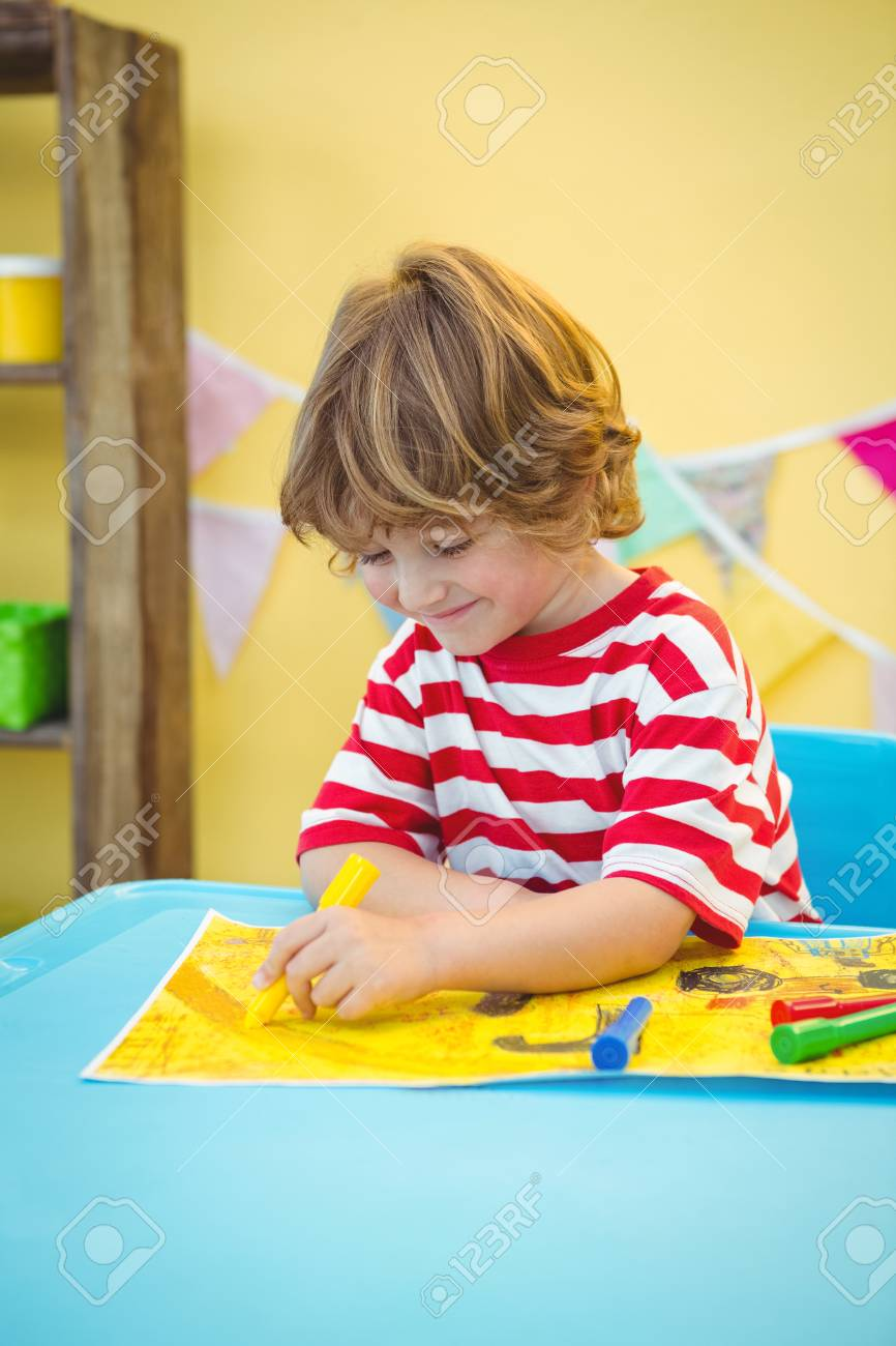 Small Boy Colouring In His Picture At The Desk Stock Photo, Picture ...
