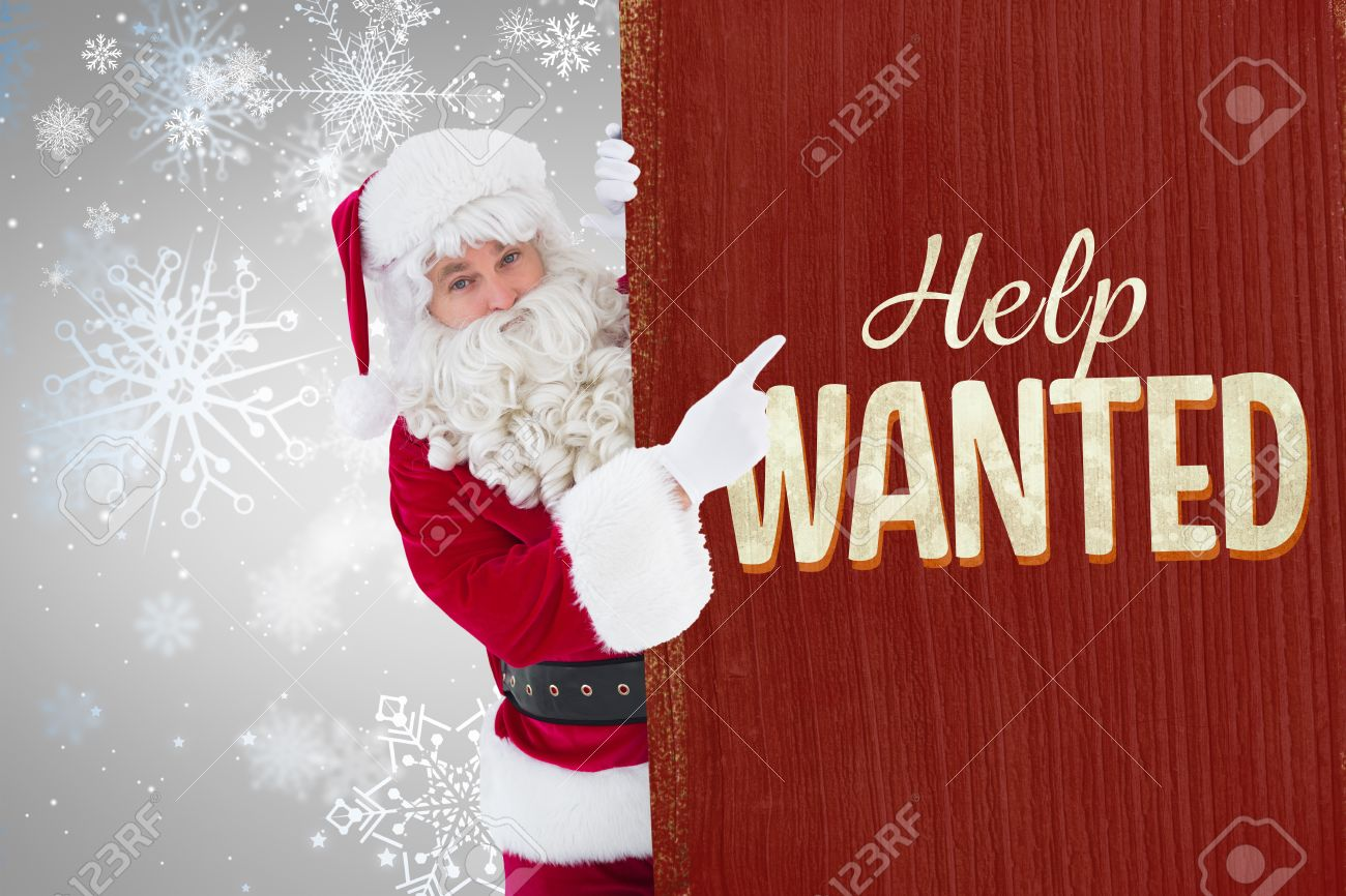 Christmas Help Wanted.Smiling Santa Claus Pointing Poster Against Vintage Help Wanted