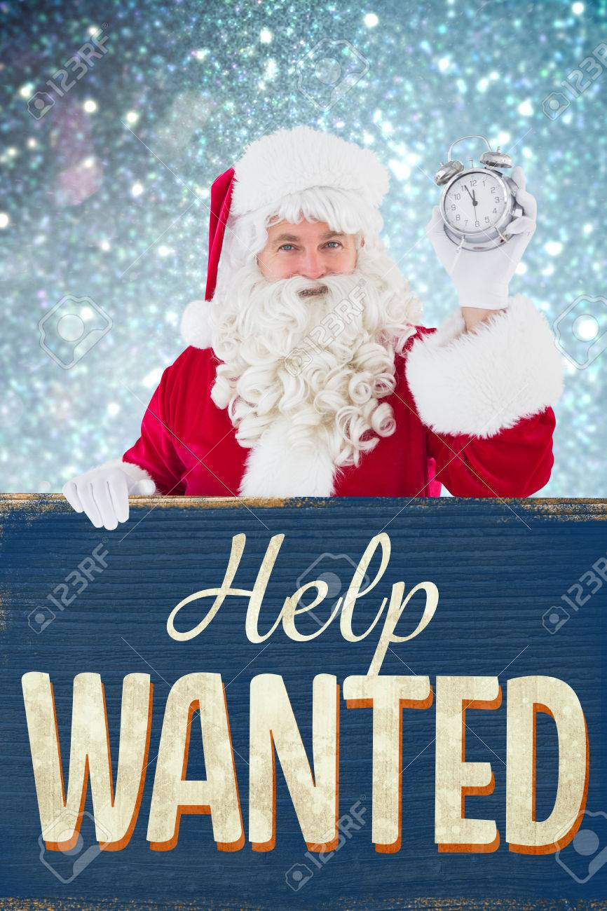 Christmas Help Wanted.Santa Claus Holding Alarm Clock And Sign Against Vintage Help