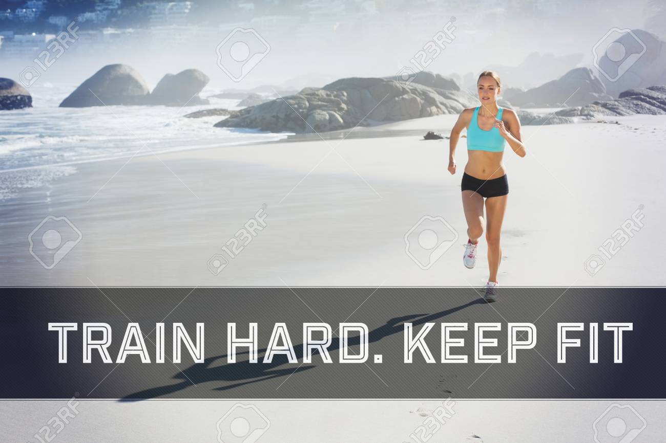 Fit Woman Jogging On The Beach Against Motivational New Years ...