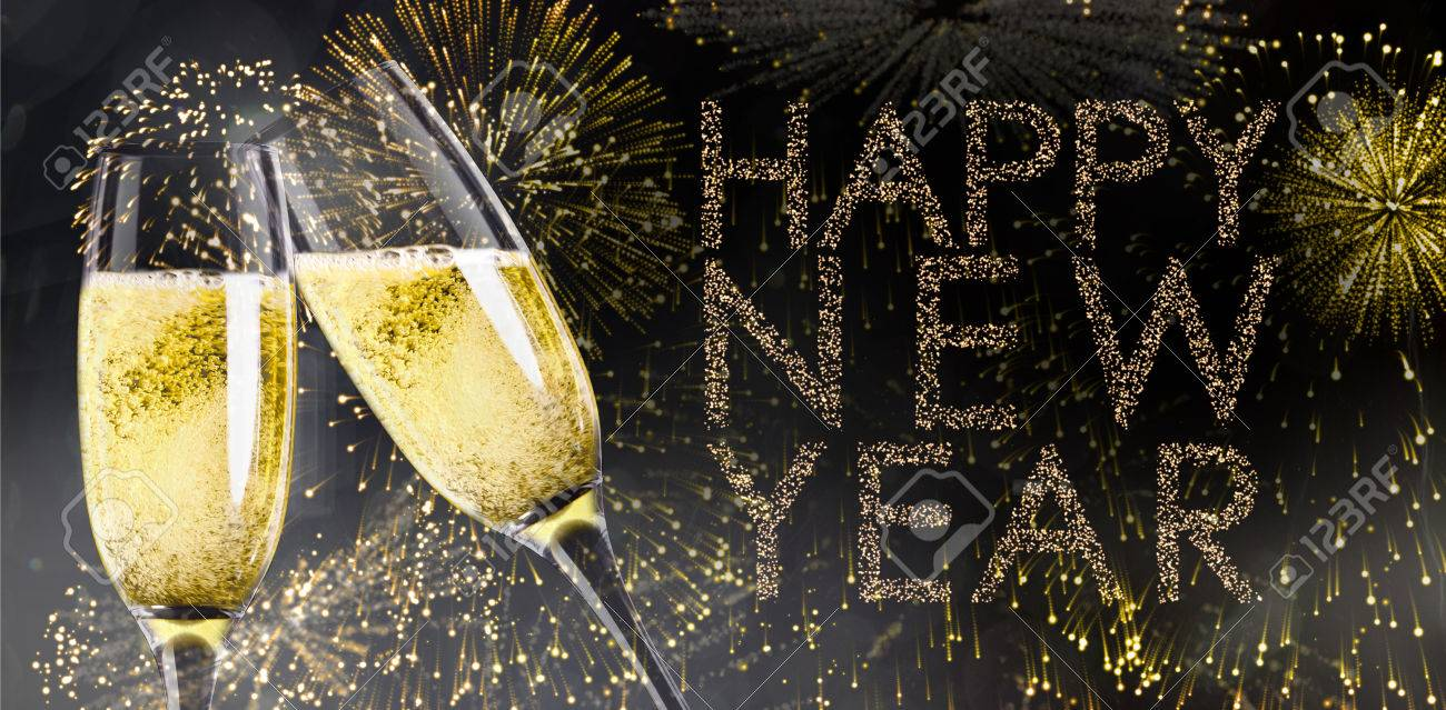 champagne glasses clinking against glittering happy new year stock photo 48593495