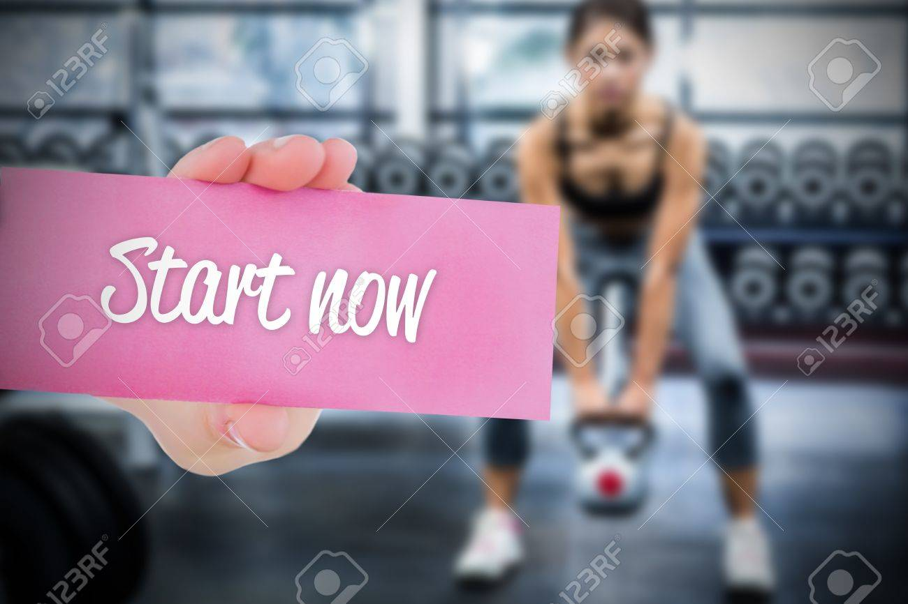 The word start now and young woman holding blank card against Stock Photo - 51012016