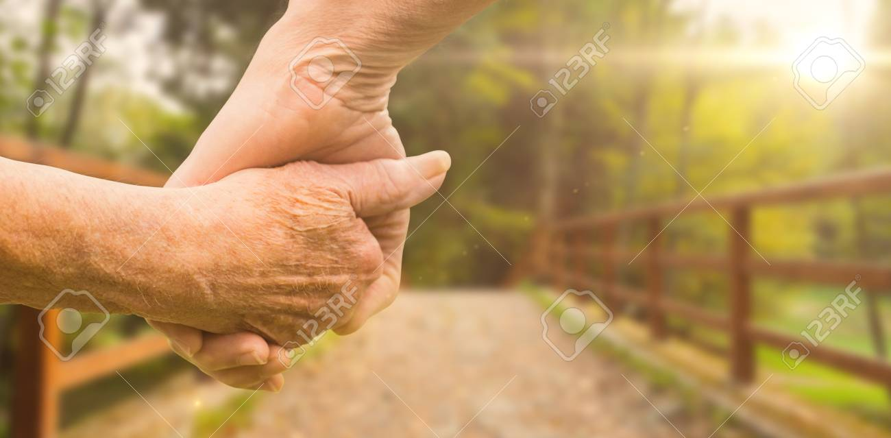 Picture of elderly couple holding hands
