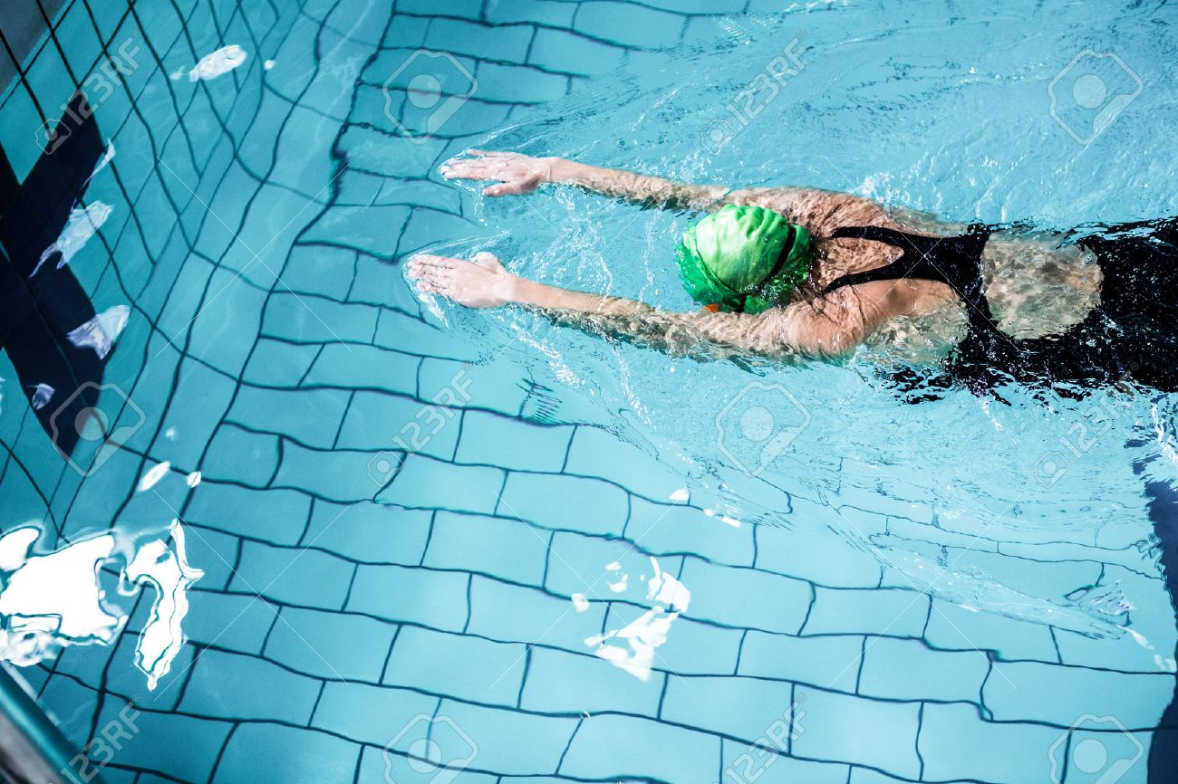 Fit woman swimming with swimming hat in swimming pool Stock Photo - 51356926