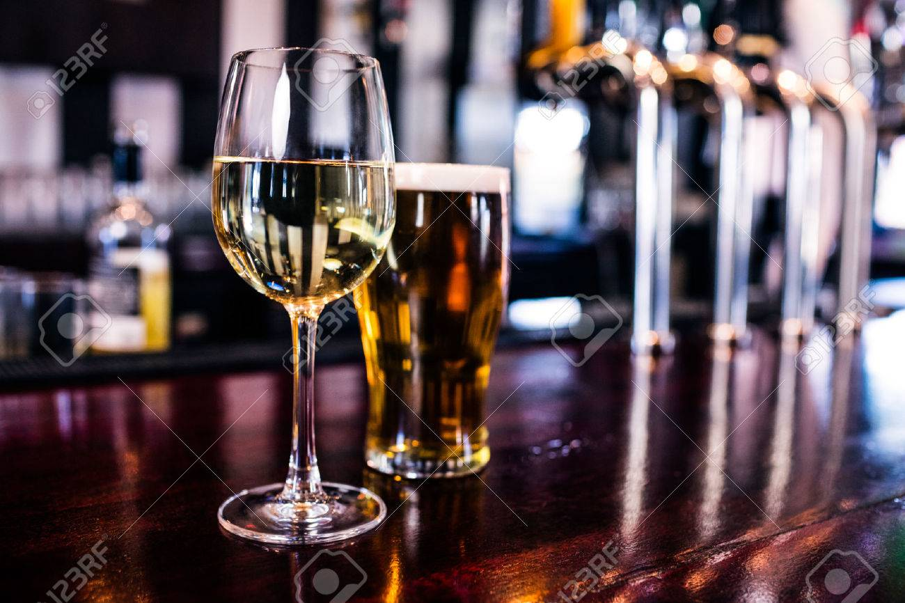 Close up of a glass of wine and a beer in a bar Stock Photo - 52034338
