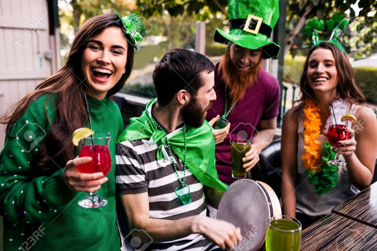 Friends celebrating St Patricks day with drinks in a bar Stock Photo - 52035113
