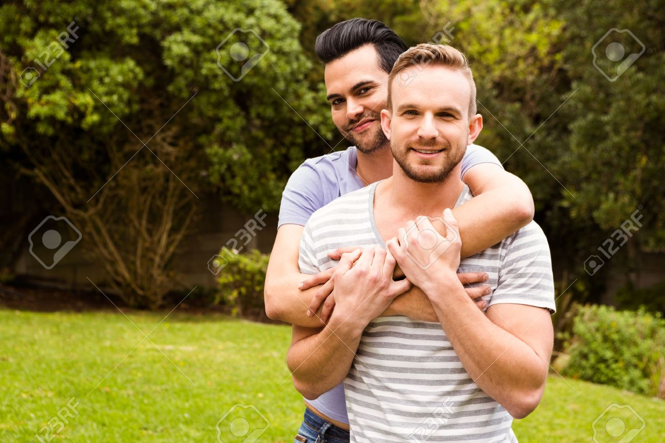 Smiling gay couple hugging in garden Stock Photo   52102022. Smiling Gay Couple Hugging In Garden Stock Photo  Picture And