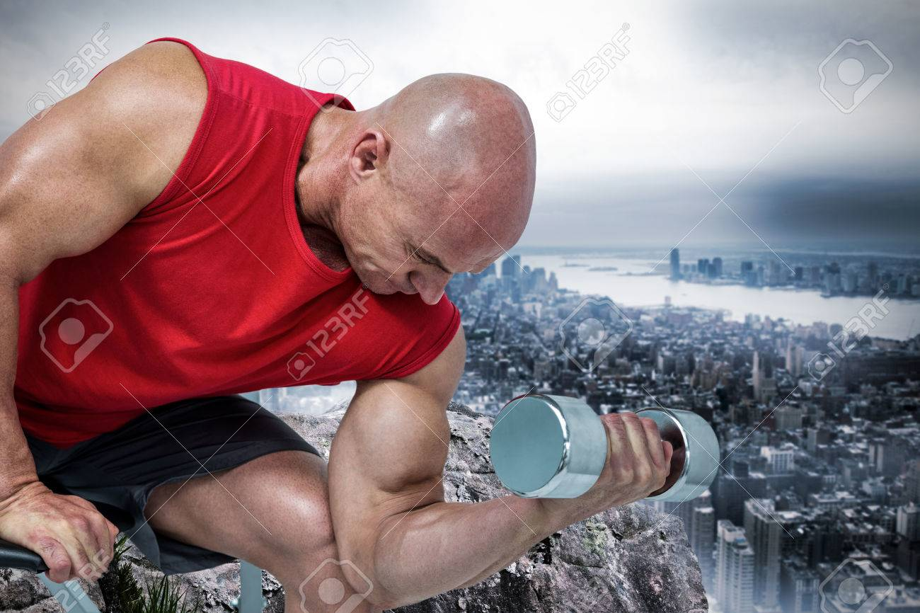 Bald Man Exercising With Dumbbells While Sitting On Bench Press Stock Photo Picture And Royalty Free Image Image 52127124