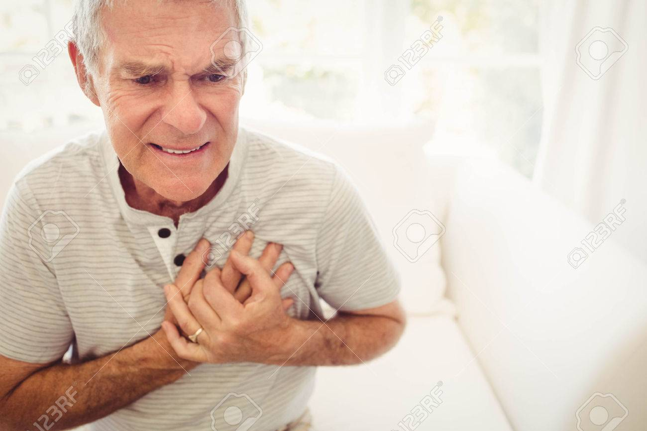 Senior man with pain on heart in bedroom Stock Photo - 52334862