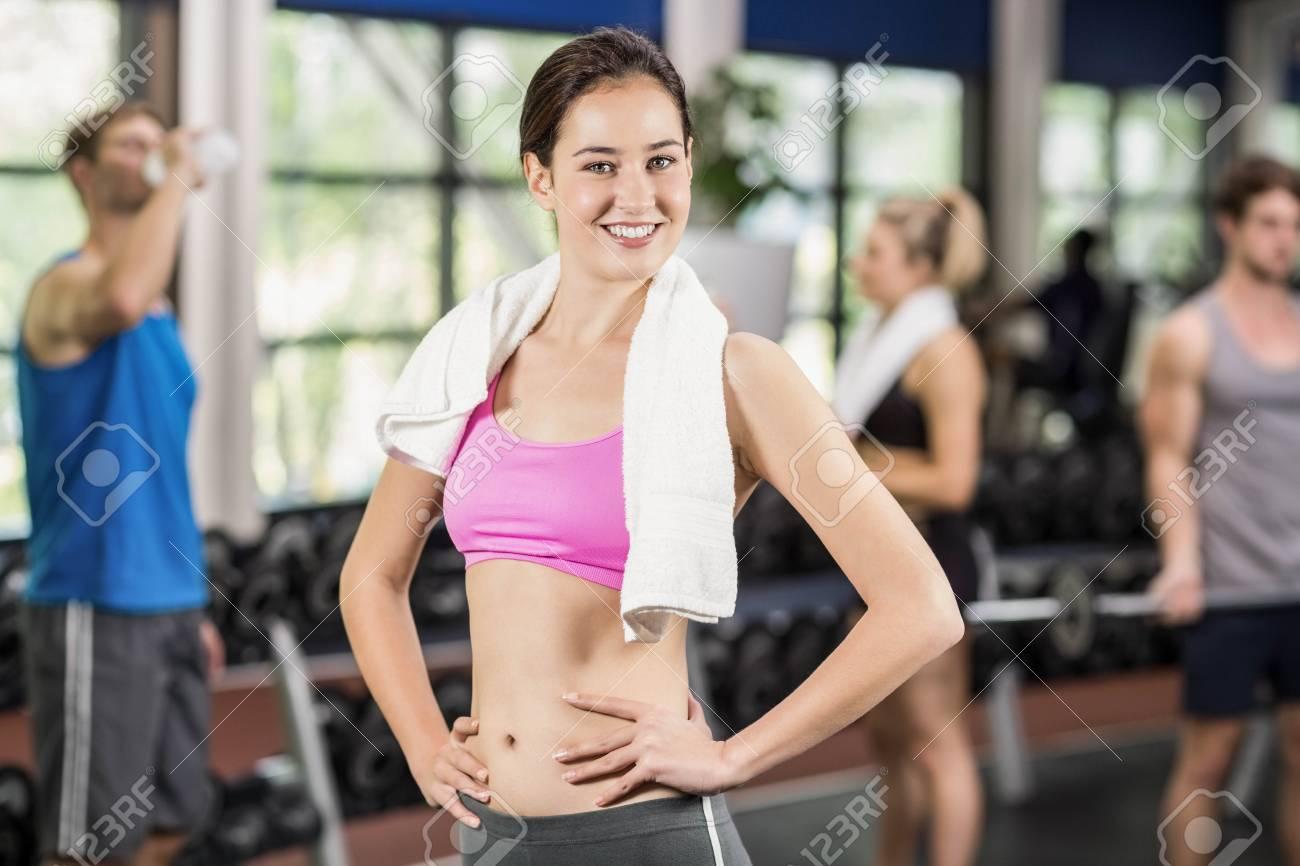 Fit Woman Posing With Athletic Women And Man Behind At Crossfit Stock Photo Picture And Royalty Free Image Image 52852011 Beautiful slim woman in underwear posing isolated on grey. 123rf com