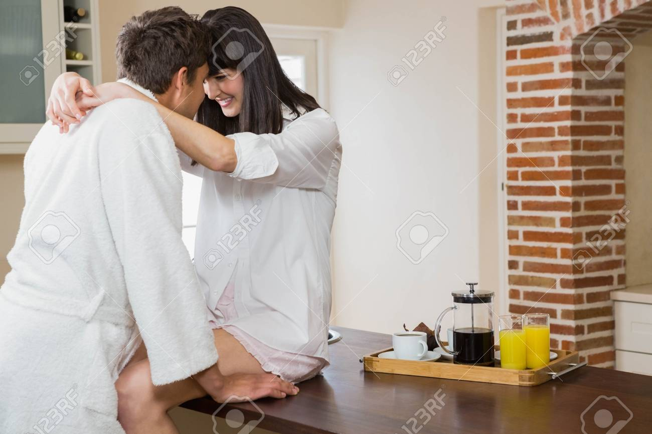 Romantic Young Couple Embracing Each Other In Kitchen Stock Photo ...