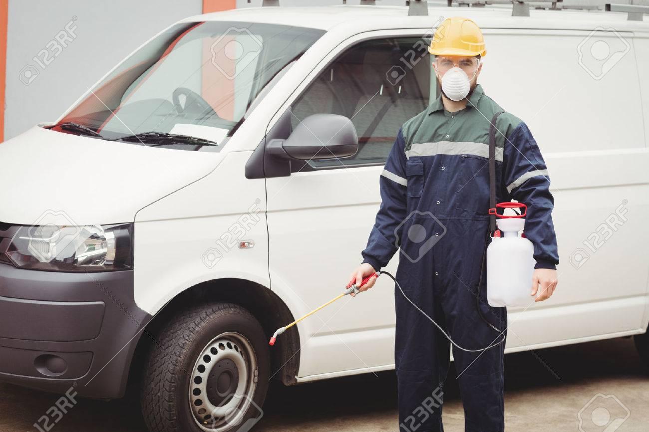 Handyman with insecticide standing in front of his van Standard-Bild - 53818397