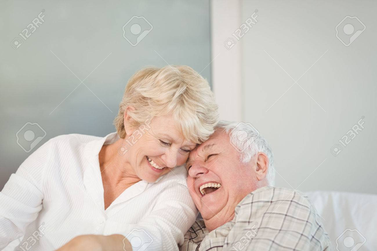 Happy senior couple laughing in bed at home Standard-Bild - 53957303
