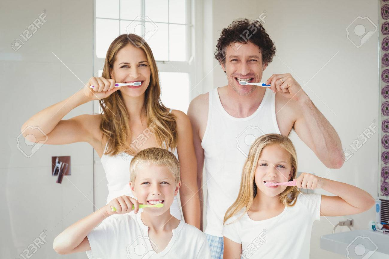 Portrait of smiling happy family brushing teeth at home Standard-Bild - 54311354