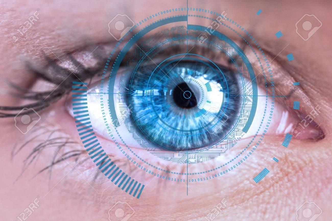 Digital composite of Eye scanning a futuristic interface Standard-Bild - 54463564