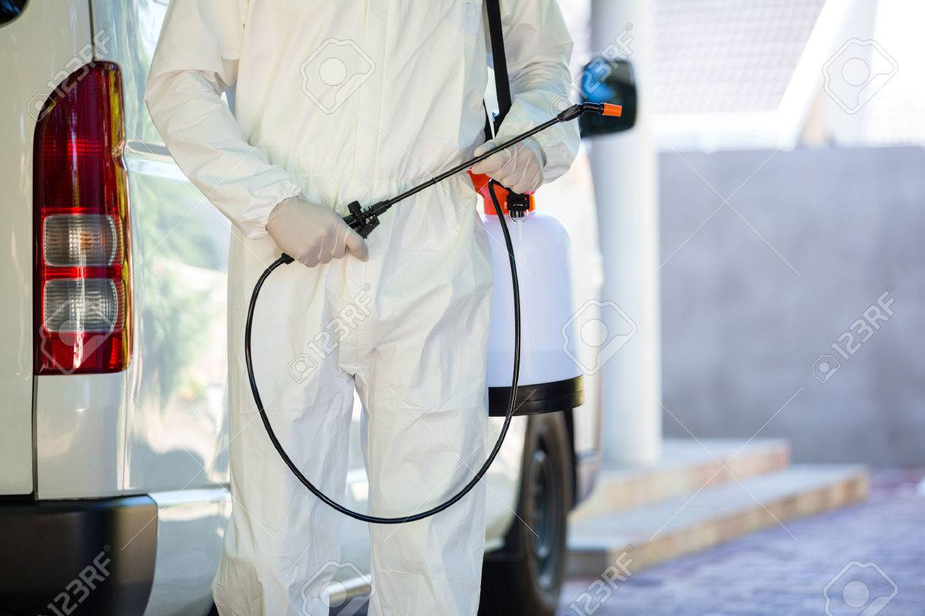 Mid section of pest control man standing next to a van on a street Stock Photo - 54924489