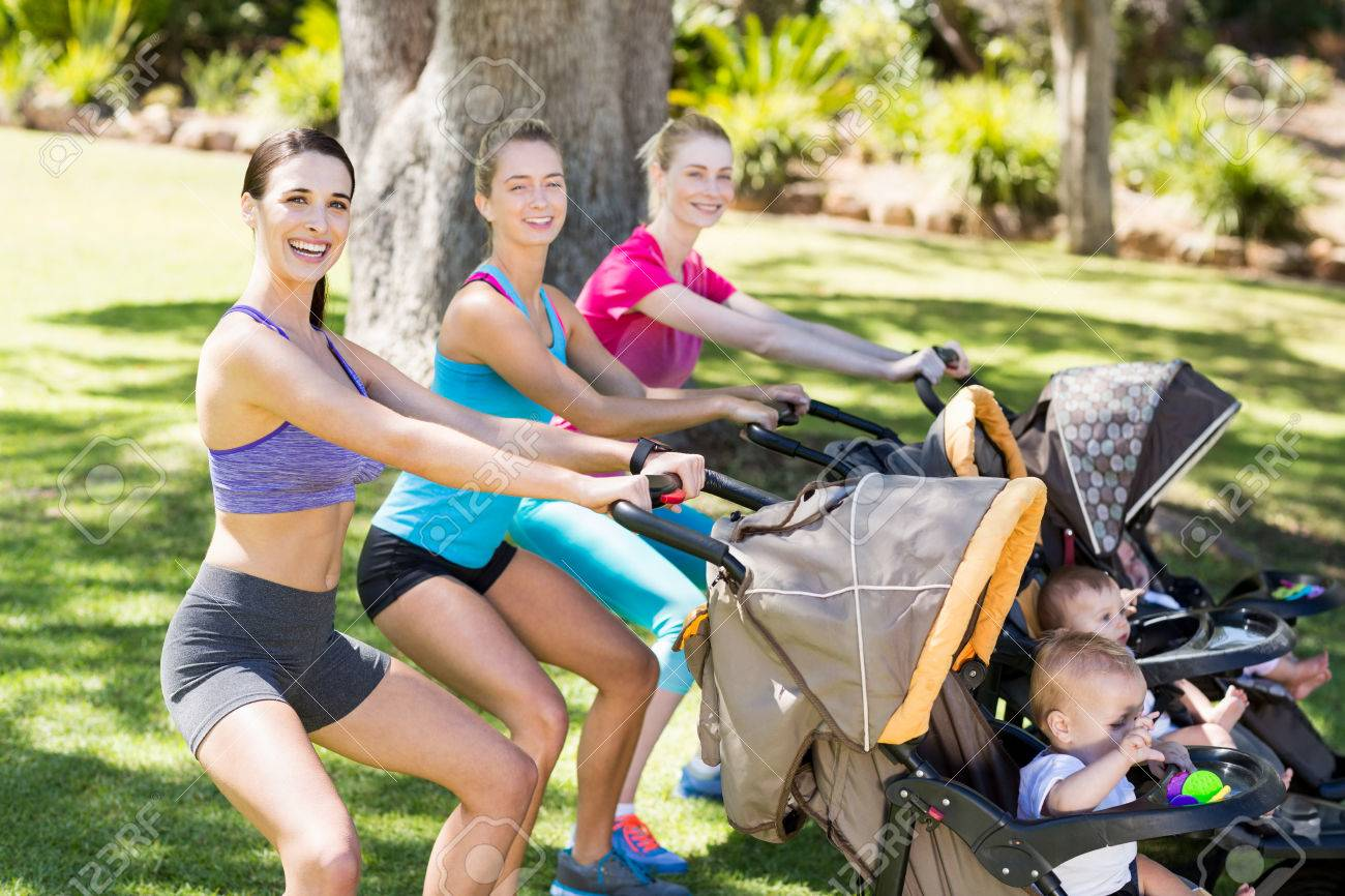 Women exercising with baby stroller in park Stock Photo - 59103024